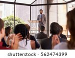 audience applauding speaker at... | Shutterstock . vector #562474399