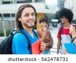 laughing hipster male student... | Shutterstock . vector #562478731