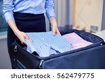 business  trip  luggage and... | Shutterstock . vector #562479775