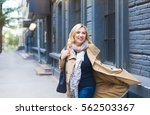 middle age woman goes through... | Shutterstock . vector #562503367