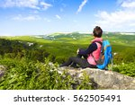 hiker with backpack relaxing on ... | Shutterstock . vector #562505491