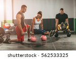 young woman and man exercising... | Shutterstock . vector #562533325