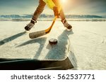 ice hockey on the frozen lake... | Shutterstock . vector #562537771