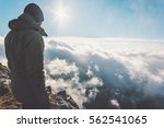 man on mountain summit with sun ... | Shutterstock . vector #562541065