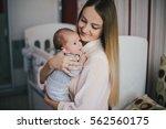 newborn baby on his mother's... | Shutterstock . vector #562560175