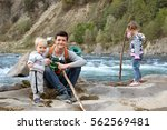 three different aged children... | Shutterstock . vector #562569481