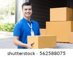 a man carrying  package from... | Shutterstock . vector #562588075