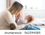 mother with her newborn baby... | Shutterstock . vector #562594585