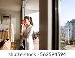 Woman Relaxing On Balcony...