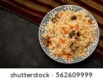 pilaf on plate with oriental... | Shutterstock . vector #562609999