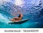 active girl in bikini in action.... | Shutterstock . vector #562640059