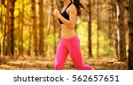 young woman running on the...   Shutterstock . vector #562657651