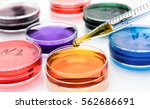 pipette with drop of color... | Shutterstock . vector #562686691