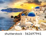 beautiful sunset over oia town... | Shutterstock . vector #562697941
