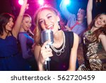 young girl singing into ... | Shutterstock . vector #562720459