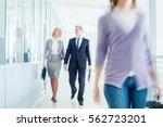 businesspeople walking in the... | Shutterstock . vector #562723201