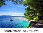 Beautiful beach Zlatni Rat or Golden Cape on island Brac in Croatia with yacht - stock photo