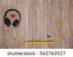 headphones with heart of yellow ... | Shutterstock . vector #562763527