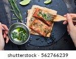 hands brush the marinade is... | Shutterstock . vector #562766239