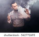 vaper man holding e liquid  ... | Shutterstock . vector #562772695