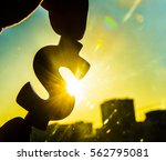 hand hold silhouette of dollar... | Shutterstock . vector #562795081