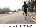 rear view of a woman running in ... | Shutterstock . vector #562799605