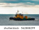 Small Orange Tug Ship Moving...