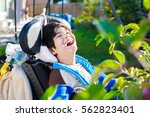 disabled biracial ten year old... | Shutterstock . vector #562823401