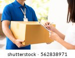 woman receiving package from  a ... | Shutterstock . vector #562838971