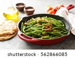 green beans with caramelized... | Shutterstock . vector #562866085