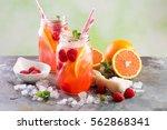 pink berry and orange lemonade... | Shutterstock . vector #562868341