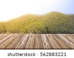 empty top of wooden table and... | Shutterstock . vector #562883221