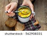 woman hands holding mug of... | Shutterstock . vector #562908331