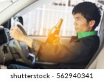 blurred of drunk young man... | Shutterstock . vector #562940341