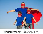 father and children playing... | Shutterstock . vector #562942174