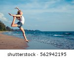 one teen girl  jumping on the... | Shutterstock . vector #562942195