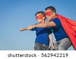 father and son playing... | Shutterstock . vector #562942219