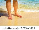 people standing in the sea.... | Shutterstock . vector #562965391