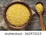 bulgur in wooden bowl and... | Shutterstock . vector #562973215