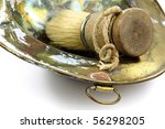 shaving brush and old shaving dish on a white background - stock photo