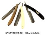 three old and worn rusty razors on a white background - stock photo