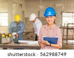 three happy builders in hardhat ... | Shutterstock . vector #562988749