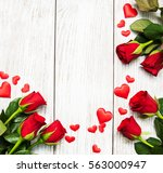 Stock photo red rose with hearts on a old wooden table 563000947