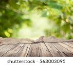 empty table for display montages | Shutterstock . vector #563003095