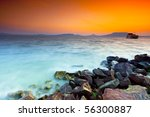 Beatiful sunset on the rocks - stock photo