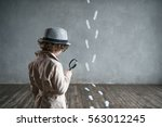 detective with a magnifying... | Shutterstock . vector #563012245