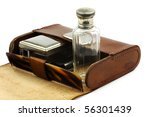 Old leather shaving kit on a white background - stock photo
