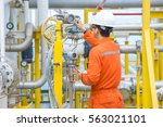 Small photo of Technician operator checking reading value from pressure and temperature transmitter of oil and gas process to find abnormal condition, Offshore business and occupational.