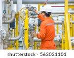 technician operator checking... | Shutterstock . vector #563021101