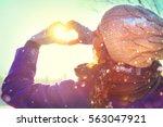 winter girl showing valentine... | Shutterstock . vector #563047921